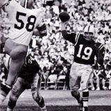 John Unitas gets off a pass against Green Bay Packer Dan Currie