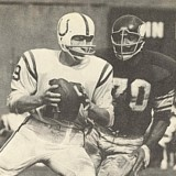 Viking defender Jim Marshall puts the heat on Colts QB John Unitas