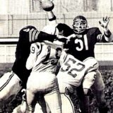 Dick Butkus and others pressure Colts QB Johnny Unitas
