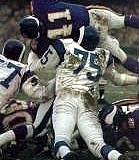 Deacon Jones helps put a stop on Vikings QB Joe Kapp