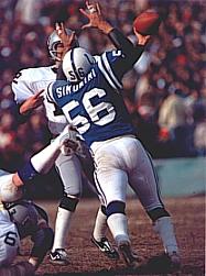 Raiders Quarterback Kenny Stabler under pressure from Colts linebacker Ed Simonini