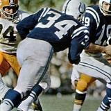 Colts running back Joe Perry sets to take a hand off from Johnny Unitas