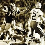 Rams defender Merlin Olsen puts pressure on Roger Staubach
