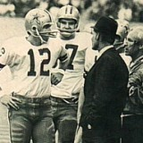 Roger Staubach talks with Cowboys head coach Tom Landry on the sidelines