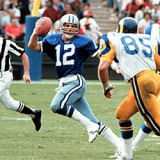 The Rams Jack Youngblood applies pressure to the Cowboys Roger Staubach