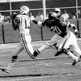 Don Maynard runs away from a Kansas City Chief defender in AFL action