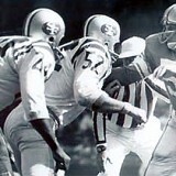 Lions Linebacker Joe Schmidt against Karl Rubke and JD Smith of the 49ers
