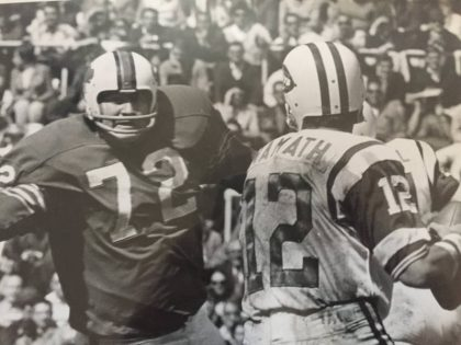Joe Namath under pressure from Ron McDole