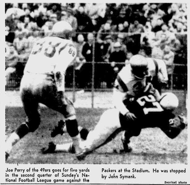 Joe Perry of the 49ers runs against the Packers in 1958