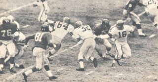 Jim Brown carries against the Giants in 1961