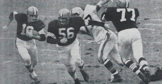 Milt Plum gets behind the Blocking of Dick Schafrath and John Morrow