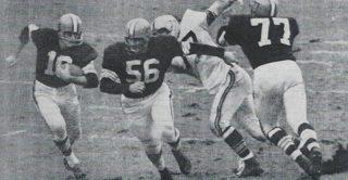 Milt Plum gets behind the Blocking of Dick Schafrath and John Morrow