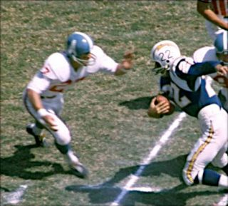 Fred Glick of the Houston Oilers Moves in on Keith Lincoln of the Chargers