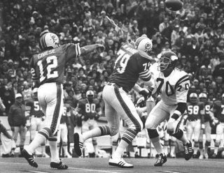 Jim Marshall of the Vikings Pressures Bob Griese as Wayne Moore Blocks